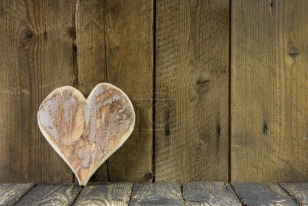 Photo for On old rustic background one heart of wood for greeting card. - Royalty Free Image