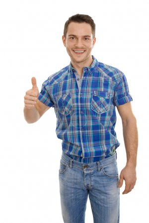 Isolated happy young man in blue with thumbs up.