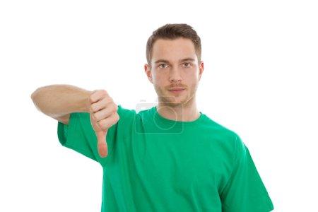 Photo pour Portrait isolé de jeune homme intelligent avec pouce baissé sur fond blanc . - image libre de droit