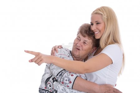 Young woman with her grandmother presenting.