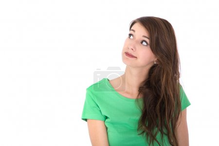 Face of a pretty brunette girl isolated on white looking up.