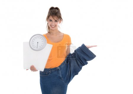 Slim young girl presenting new product for diet.