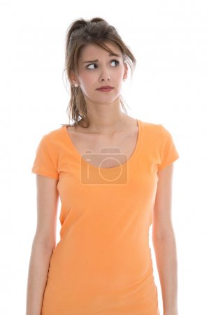 Pensive and doubtful young isolated woman wearing summer shirt.