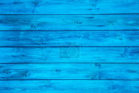 Surface of an empty blue wooden background.