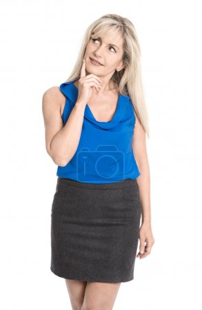 Attractive reflective middle aged woman in summer clothes lookin