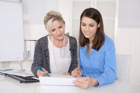 Photo for Two attractive business woman in meeting analyzing budget. - Royalty Free Image