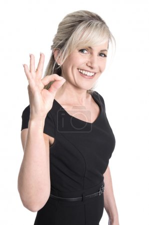 Charming older business woman making excellent symbol with finge