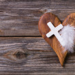 Wooden background - olive heart and white cross fo...