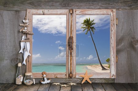 Photo for Holiday in paradise: wooden window sill with view to the beach. - Royalty Free Image