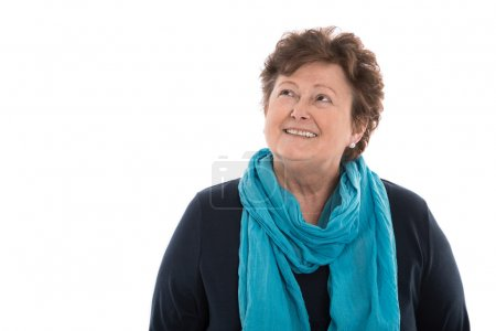 Portrait: older woman isolated over white smiling up to text.