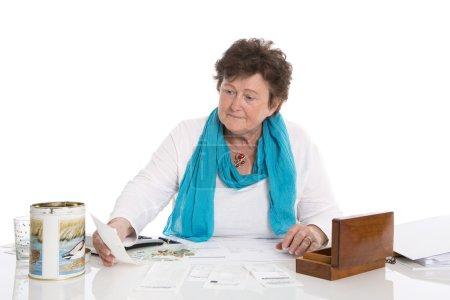 Portrait: Sad, poor and depressed old woman: Concept pensioner m