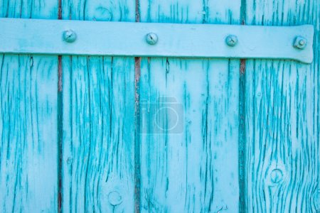 Old rustic wooden background in turquoise color.