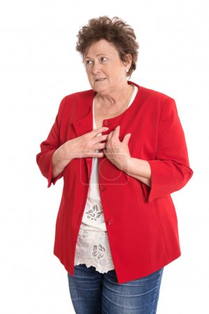 Photo for Portrait of an isolated older woman in red has heart problems. - Royalty Free Image