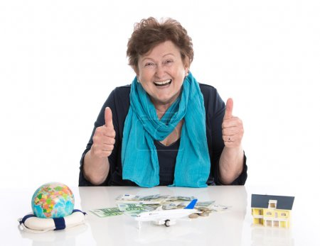 Isolated happy senior woman or pensioner - money concept for tra