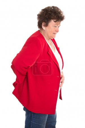 Isolated female senior in red has backache or rheumatism.