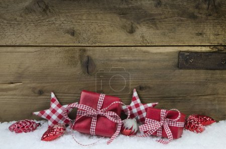 Red checked christmas presents on wooden country style backgroun