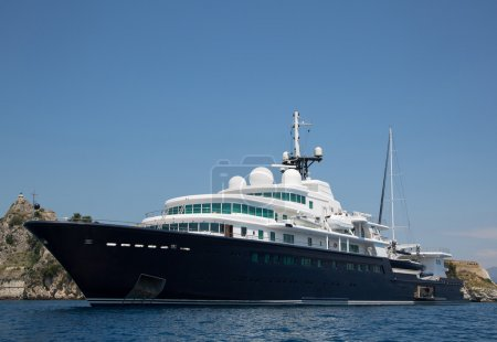 Gigantic big and large luxury yacht with sail boat...