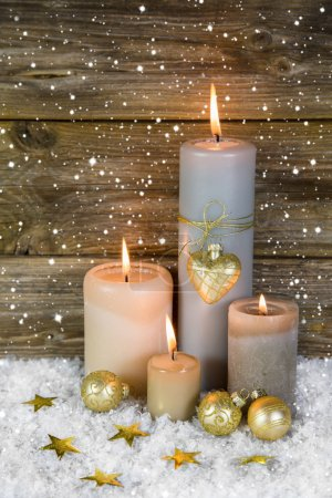 Festive christmas decoration in gold and white: four red burning
