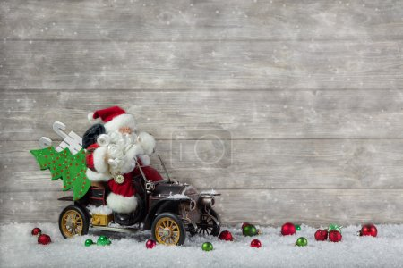 Christmas decoration: Red santa claus in hurry to buy christmas