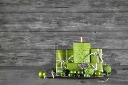 Wooden christmas or advent background with green decoration, can