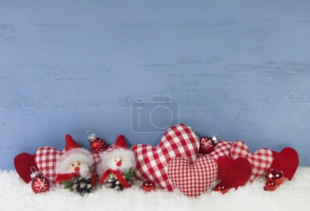 Blue wooden christmas background with brownie and red checked he