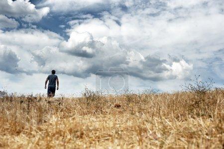 Man walking in a field