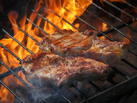 A top sirloin steak flame broiled on a barbecue, shallow depth o