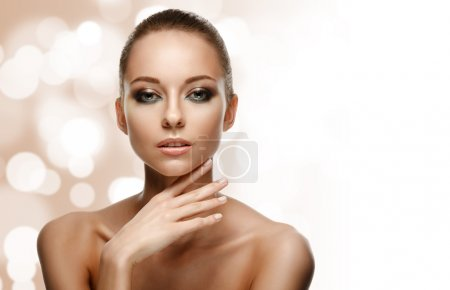 Photo for Beauty Portrait. Beautiful Woman Touching her Face. Perfect Fresh Skin. Pure Beauty Model. Youth and Skin Care Concept - Royalty Free Image