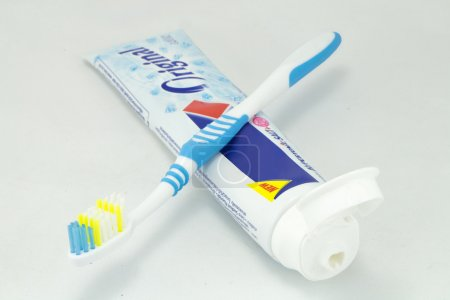 Toothbrush and toothpaste tubes