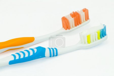 Several toothbrush put in storage and toothpaste