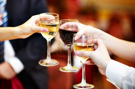 People holding glasses of alcohol