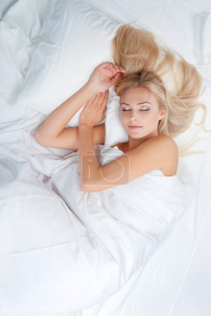 Blonde beautiful woman sleeping