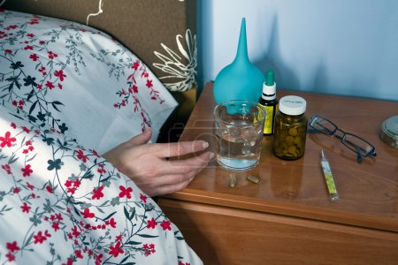 Sick Person take their medication at night