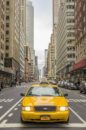 Photo for NEW YORK - DECEMBER 22, 2013: yellow taxi in Manhattan,New York. The city is planning to replace its fleet of various kinds of taxis with one model. - Royalty Free Image