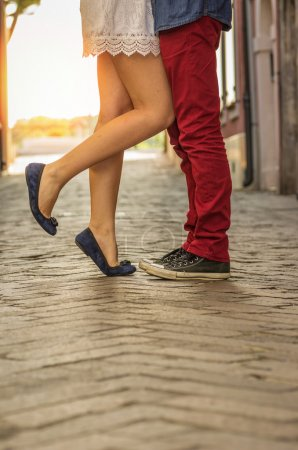 Photo for Couple kissing outdoor - close up on feet - Royalty Free Image