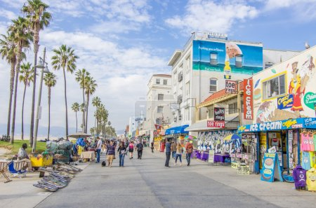 Photo for VENICE,CA - DECEMBER 18, 2013: Ocean Front Walk of Venice Beach in Venice, US. This boardwalk is 2.5 kilometer long - Royalty Free Image