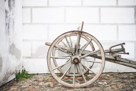 Vintage Old Wooden Ploughe with Renaissance Sgrafito Wall on Background Photo