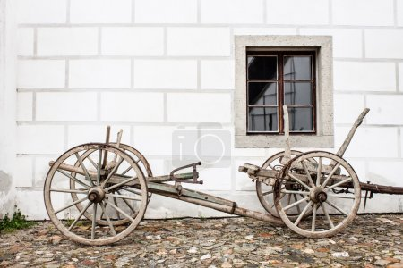 Vintage Old Wooden Ploughe with Renaissance Sgrafito Wall on Bac
