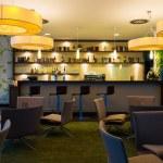 Nice hotel lounge bar with bottle shelfs and seats...