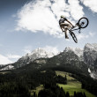 Young freestyler jumps with his bmx high into air ...