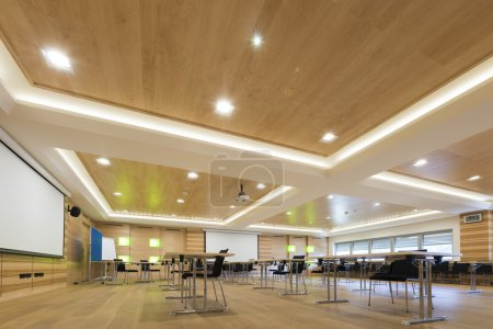 Wooden architecture of modern conference room with cahirs and tables