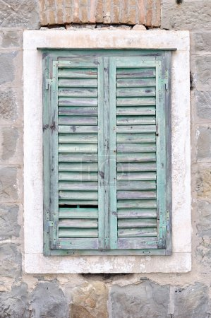 Photo for The old window with blue closed shutters on an old house. Vintage background, texture - Royalty Free Image