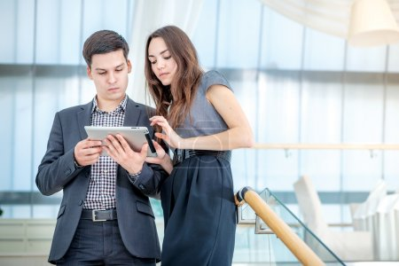 Businesspeople solve problems on the tablet.