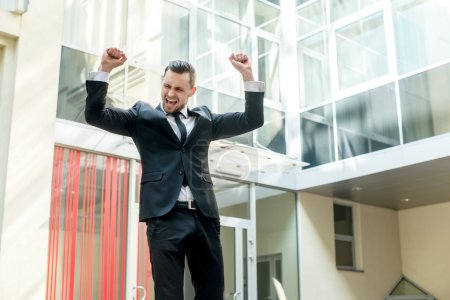 Dance success. Successful confident businessman celebrates his s
