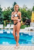 Glamorous girl  near the swimming pool