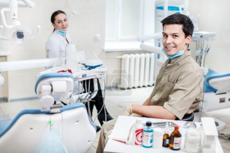 Two dentists working in a dental office