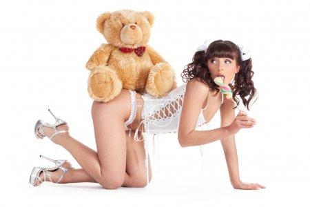 girl with candy and teddy bear