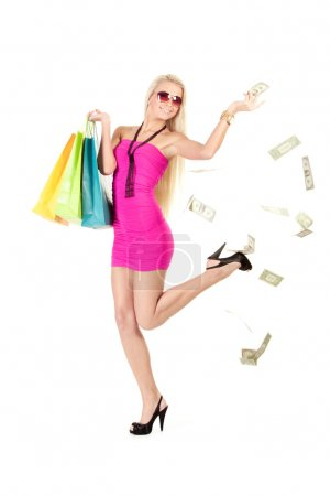 happy young woman throwing money