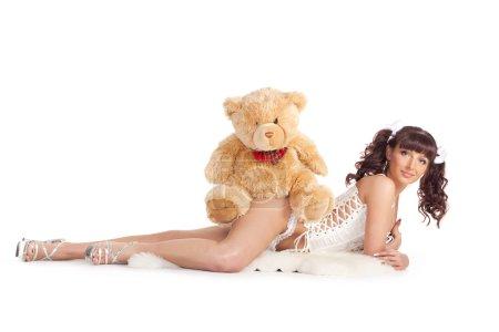 Lying with teddy bear