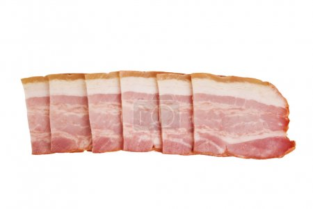 Pile of raw uncooked Sliced bacon isolated against white background